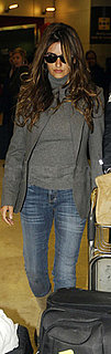Penelope Cruz Lands in Madrid Wearing Gray Sweater and Blazer