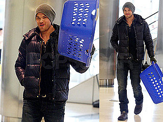 Photos of Kellan Lutz With a Laundry Basket in LA