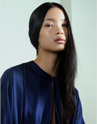 Vogue China just picked Chinese model Kiki Kang (New York) as a up-and-comer for 2010; she's already appearing in Topshop's Spring 2010 campaign.