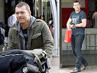 Photos of Sam Worthington Returning to Sydney With Lots of Luggage