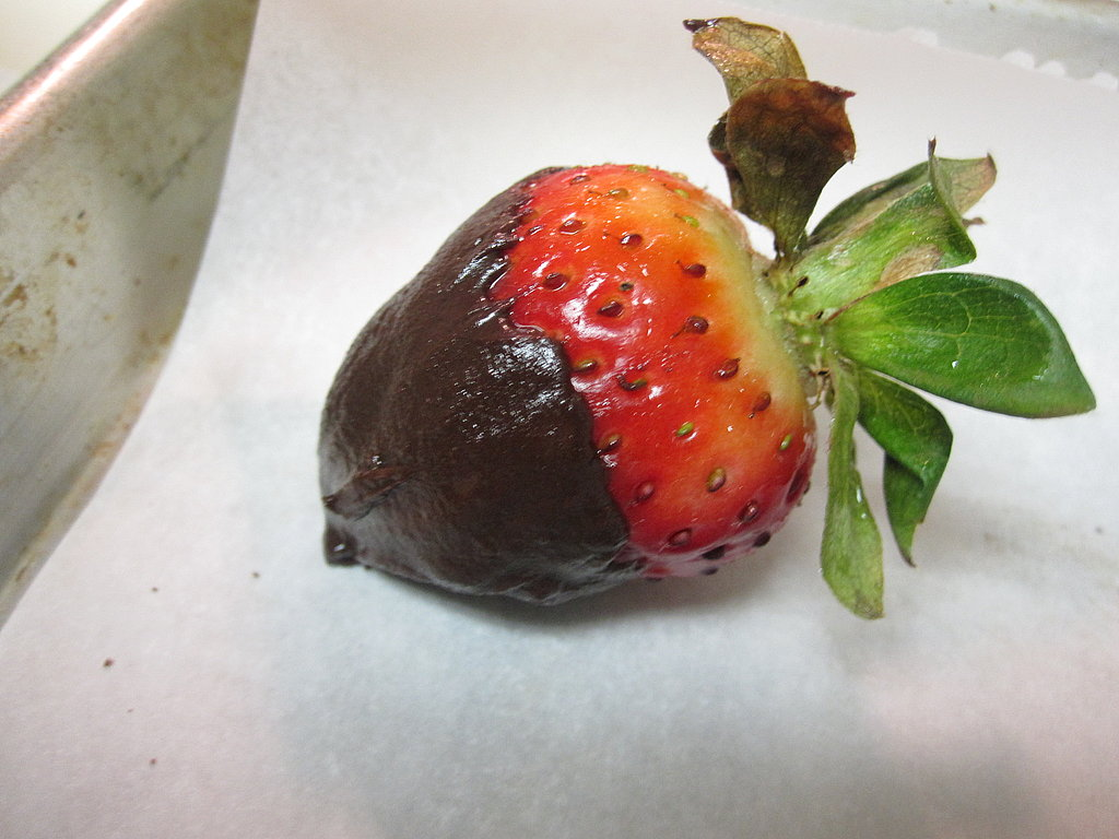 Set the chocolate-coated strawberry on the prepared baking sheet. Repeat with remaining strawberries.