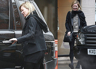 Photos of Kate Moss Taking a Break From London Fashion Week by Hanging Out With Friends and Smoking