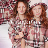 These lovely girls represent a ray of sunshine in the rain. What a great way to represent their sweetness in their check heart attire. Their twill heart shirts with roll-up sleeves make it easy to maneuver in the rain and on the playground. The matching nylon hat and umbrella represent these girls as true sweethearts.