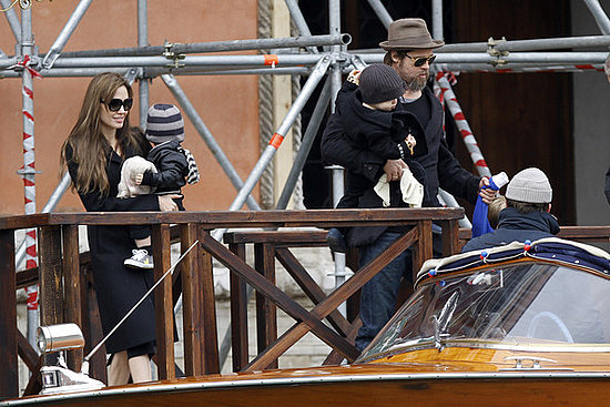 Brad Pitt and Angelina Jolie climb aboard a motor boat in Venice with their daughter Shiloh  and their twins