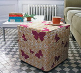 Sew an ottoman slipcover to turn a cheap purchase into something one-of-a-kind.