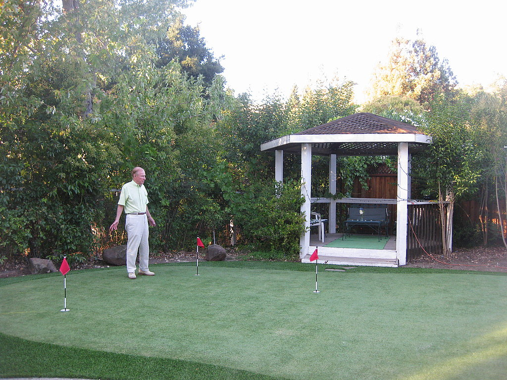 My grandfather makes sure the putting green is up to par.