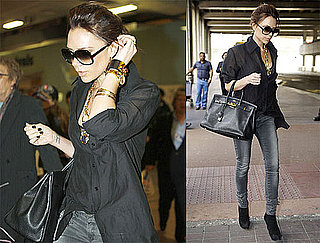 Photos of Victoria Beckham Arriving in London Wearing Sunglasses and Gray Jeans