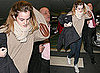 Photos of Emma Watson Arriving in London with Elbow Patches on her Jumper