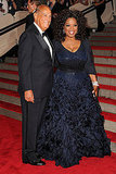 Oscar de la Renta with Oprah Winfrey, in his design