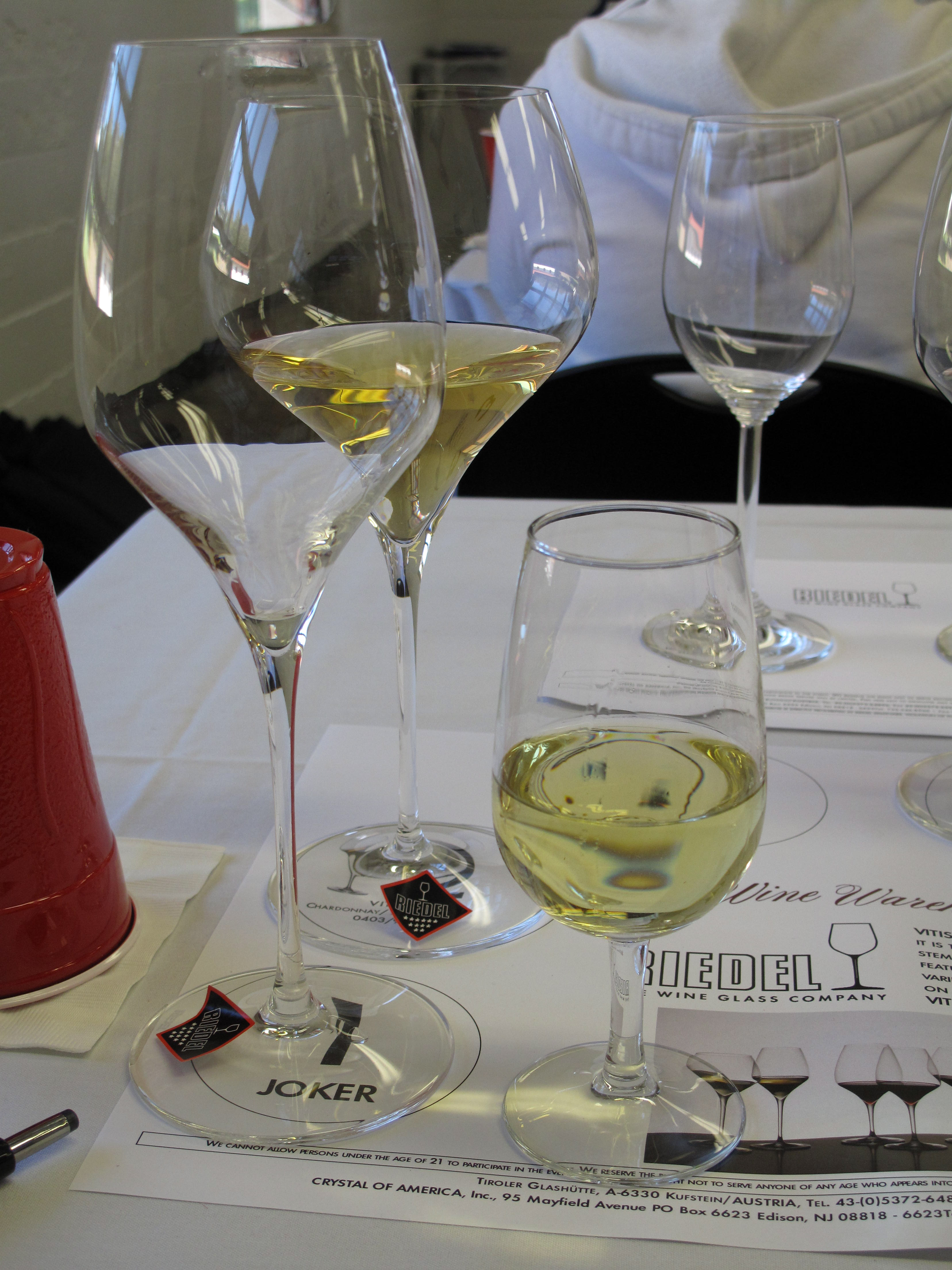 From left to right, the Vitis Riesling/Sauvignon Blanc glass, Vitis Montrachet glass, and a stout table glass. Without sufficient room for the wine to breathe in the table glass, the Riesling tasted metallic, subdued, and one-dimensional.