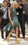 Naomi strolled the streets of Cannes in a funky print Diane von Furstenberg frock and yellow Stella McCartney platforms.