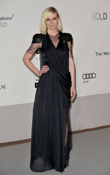 Kirsten Dunst channels a serious babe in her black Chanel draped gown.