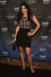 Kim Kardashian worked her usual polished self in Atlantic City in a checkered top and high-waisted black mini skirt.