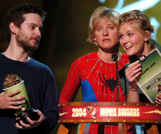 Ellen DeGeneres looked on in her Spider-Man costume as Kirsten Dunst and Tobey Maguire presented the award for best movie in 2004.