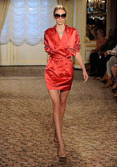 We gravitate toward mystery. Is it a dress? Is it a coat? It's a sexy red dress coat. Fabulous!