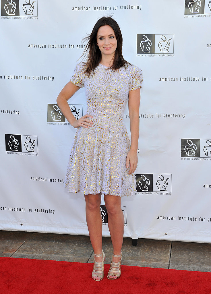 Emily's white and gold textured dress is a vision; her metallic Jimmy Choo sandals further her fancy.