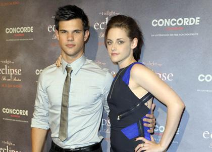 "Taylor Lautner and Kristen Stewart were spotted in Berlin, Germany for an ""Eclipse"" photo call"