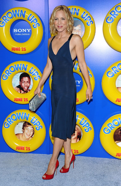 Maria Bello, sexy nautical, in a slinky navy dress, red Jimmy Choos, and silver Judith Leiber clutch.
