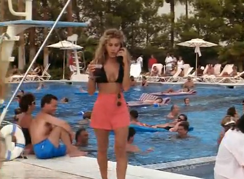 Betsy was having a miserable time at the pool alone, but she sure looked damn good in her black bikini and coral high-waisted shorts.