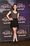 Here is a more casual cute look —a pleated black skirt and gray scoop-neck tee — at a press conference in Seoul.