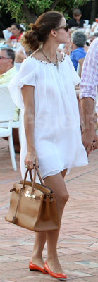 Olivia Palermo Wearing White Dress, Red Flats, and Hermes Bag in Italy