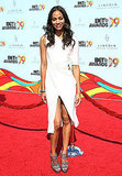 Zoe showed off her slick style in a white cutout dress by Calvin Klein at the BET Awards in LA.