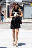 Rachel Bilson's pretty adorable in this LBD, crossbody bag, and super fly flesh-colored Rag & Bone sandals.