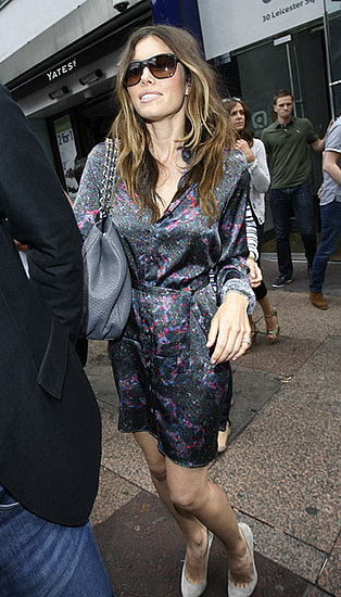 Here is a casual shot of Jessica on the streets of London, wearing a silky shirtdress and gray suede pumps.