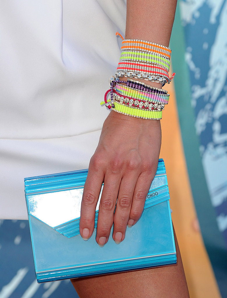 I love Cat Deeley's arm of fun and turquoise Jimmy Choo clutch.
