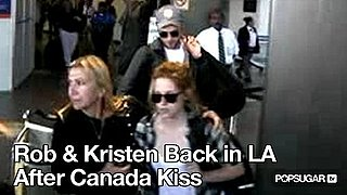Video of Robert Pattinson and Kristen Stewart at LAX 2010-08-18 10:04:06