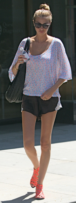 Whitney Port Wears Shorts and Orange Gladiator Sandals