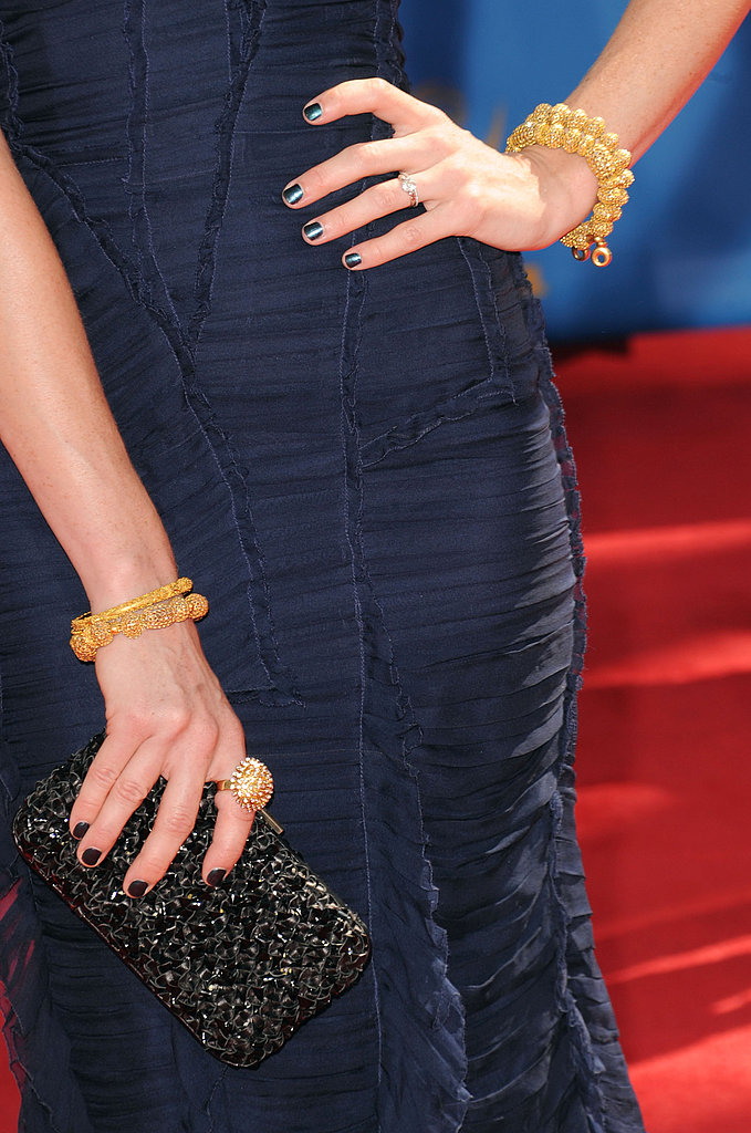 Jayma Mays's Burberry dress got a dose of glitter via gold jewels and a black clutch.
