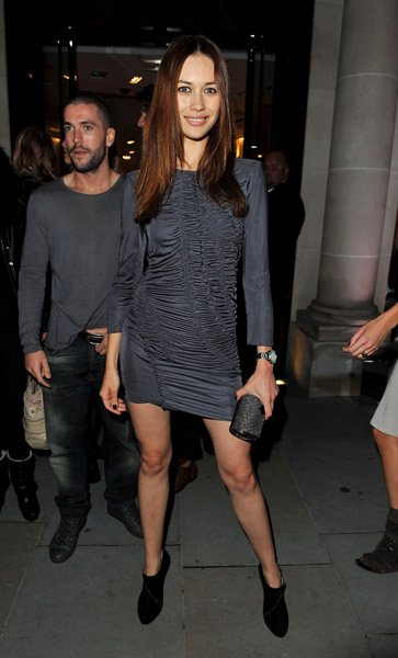 Olga Kurylenko chose a gray mini for a Burberry FNO party in London.