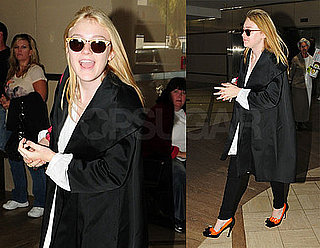 Pictures of Dakota Fanning Leaving LAX to Go to NYC For Fashion's Night Out With Prada