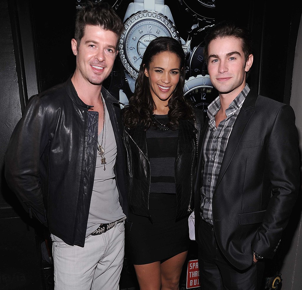 Stylish threesome: Robin Thicke and Paula Patton hang with Chace Crawford at the event.