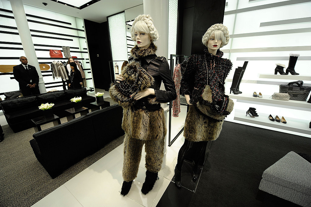 Mannequins dressed head to toe in Chanel for Fall — furry bags, pants, and luxurious separates.