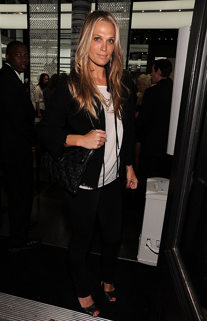 Molly Sims keeps it sleek and modern but pays homage to the design house in black and white.
