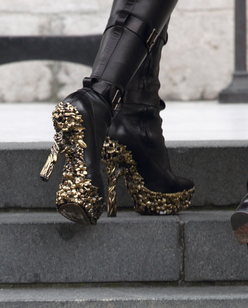 Naomi's gold-embellished boots.