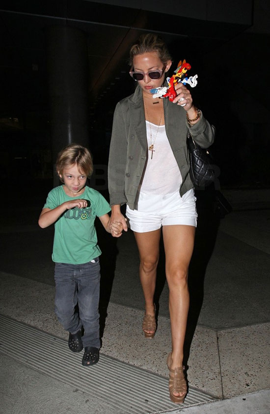 Talk about hot mama. The olive jacket is super on trend, while a white tee and shorts give it a fresh feel.