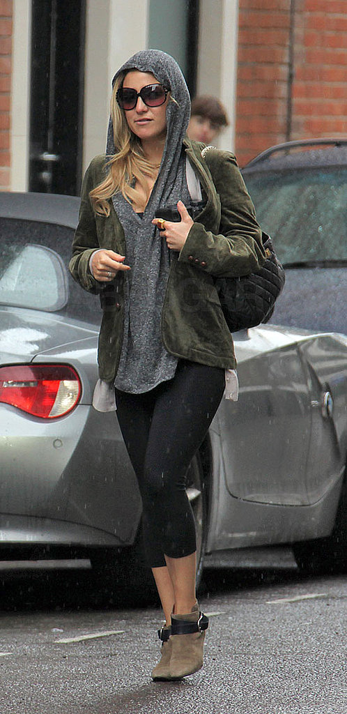 Even when she's protecting herself from the London rain she looks Fab.