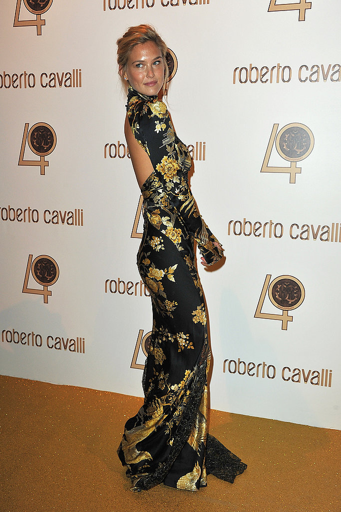 Bar Refaeli stuns in a black and gold print Cavalli.