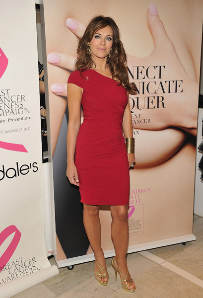 Elizabeth Hurley looked just lovely in a one-shouldered red dress, but I'm crushing hard on her chunky gold cuff.