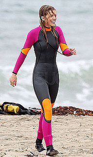 Pictures of AnnaLynne McCord Donning a Body-Skimming Wetsuit For a Surf Lesson on the 90210 Set