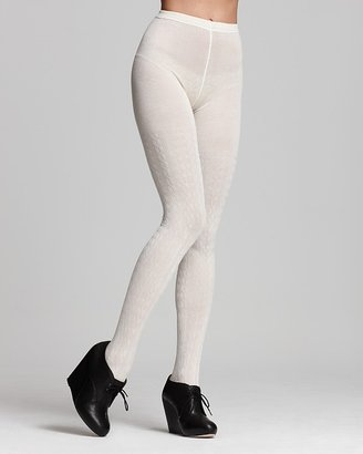 White tights are hard to pull off, but if you have the chops, get these Hue Cable Sweater Tights ($18) and wear them with a gray sweater dress.