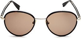 If you're daring enough to dabble with the round trend, try these The Row Round Rimmed Sunglasses ($325).