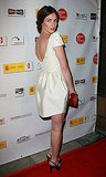 Paz Vega is the epitome of classy in her ivory scoop-back dress, slingback heels, and red patent clutch.