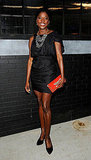 Rutina Wesley dressed up her LBD with jewels and a red clutch.
