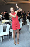 Diane Kruger flashes a smile and flaunts that trophy proudly.