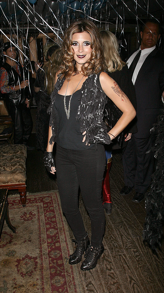 Jamie-Lynn Sigler donned dark lips, bird wings, and leather gloves — I'm thinking crow-meets-biker-babe?