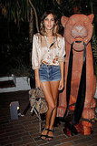 Silky top and thigh-high denim at a Mulberry pool party this Summer.